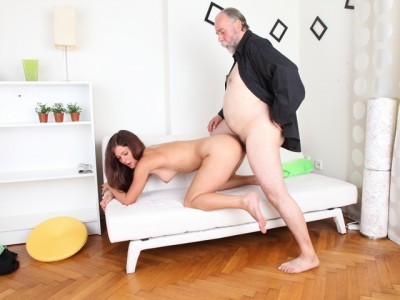 Alyona is a sexy young woman and she is sitting on the lap of her older sexy man cover