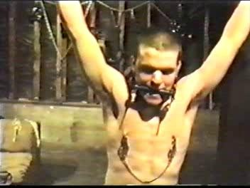 Then the slave is spread-eagled and has his crotch and pits shaved clean
